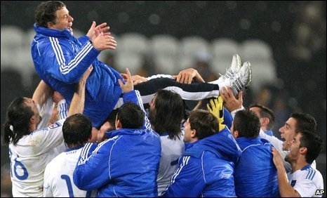 The Greeks celebrate by hoisting coach Otto Rehhagel aloft