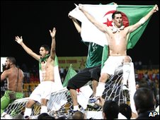 Algerian players celebrate their win