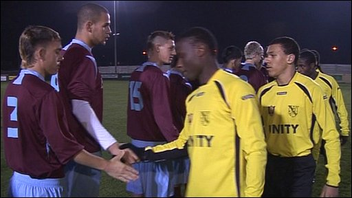 Unity FC players shake hands with their opponents after 90 minutes of action