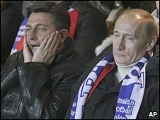 Slovenian PM Borut Pahor (left) and his Russian counterpart Vladimir Putin watch the first play-off match in Moscow. Photo: 14 November 2009