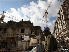 Palestinian labourer working on large apartment building complex being built in southern Jerusalem settlement of Gilo