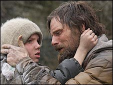Viggo Mortensen with Kodi Smit-McPhee (l) in The Road