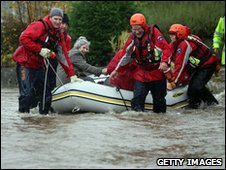 Team rescue elderly woman in Keswick
