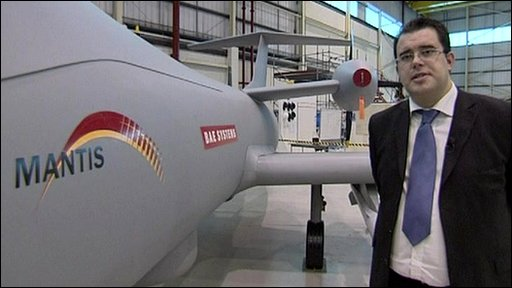 Ian Muldowney of BAE Systems next to one of their new Mantis drones