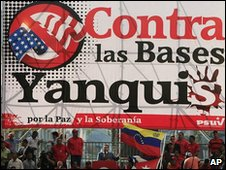 "Venezuelan President Hugo Chavez speaks under a banner reading ""Against the Yankee Bases"" in Caracas, 13 November 2009"