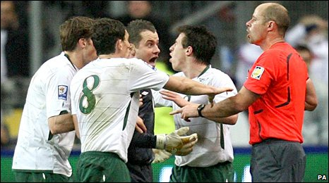 The Republic of Ireland players remonstrate with the referee after William Gallas' goal
