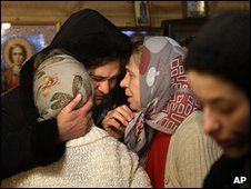 Parishioners grieve in St Thomas Church, Moscow, Russia, after the priest is shot