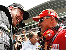 Ross Brawn chats to Michael Schumacher at the 2009 Spanish Grand Prix, with Mercedes sports boss Norbert Haug in the background