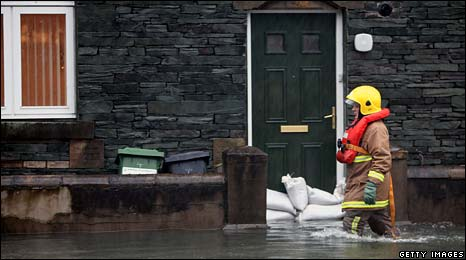 Fireman in flood water