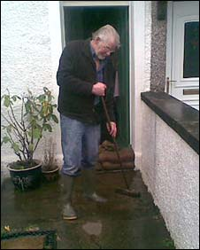 Resident sweeps water