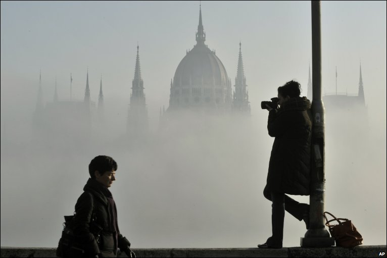 Thick fog covers the Hungarian Parliament building in Budapest