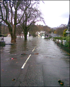 Lake Windermere floods onto a road
