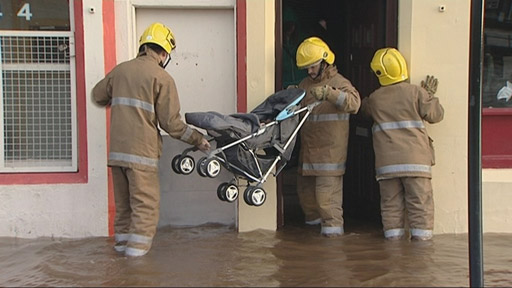 Baby boy being rescued by firefighters