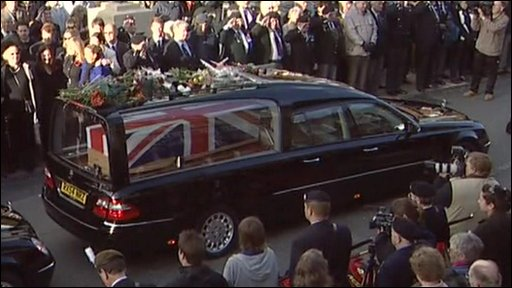 People placing flowers on the hearse of one of the repatriated soldiers in Wootton Bassett