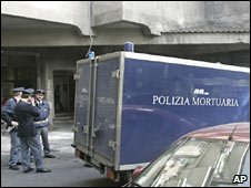 A police mortuary van is seen outside the flat in Rome where the body was found on Friday