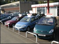 Cars for sale on a forecourt of a car dealership