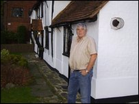 Mike Lewin outside his home