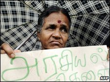 A Sri Lankan Tamil minority woman holds up a placard during a public protest in Colombo