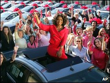 Oprah Winfrey gives cars to audience members on 9 September 2004