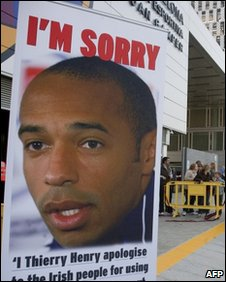 Poster of French football player Thierry Henry outside his club, FC Barcelona, highlighting his apology over the handball in the game against Ireland