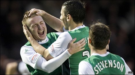 Derek Riordan is mobbed by his ecstatic Hibs team-mates after his wonder strike against St Mirren