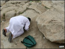 A pilgrim prays at the Mount of Mercy in Arafat