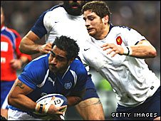 Henry Faafili of Samoa tries to elude the challenge of Pascal Pape