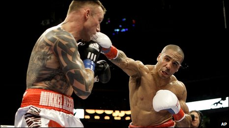 Andre Ward (right) punches Mikkel Kessler