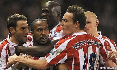 Stoke striker Ricardo Fuller (second left) is mobbed by team-mates after his winner against Portsmouth