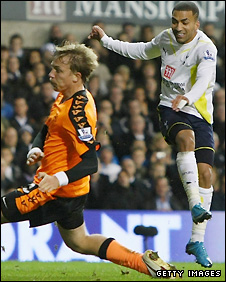 Aaron Lennon (right) shoots beyond Wigan's Erik Edman