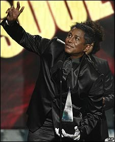 Jermaine Jackson collecting one of his brother Michael's posthumous American Music Awards