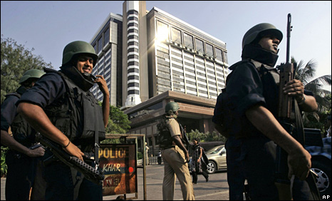 Policemen guard a Mumbai hotel