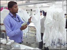 A worker in Dehli making t-shirts destined for US shops