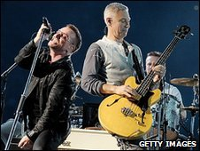 U2's Bono and Adam Clayton on stage
