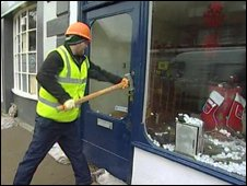 Engineer smashes open flood damged Cockermouth shop
