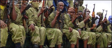 Al-Shabab Islamist fighters sit on a truck while patrolling Mogadishu