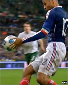 TV grab shows French forward Thierry Henry eyes the ball during the World Cup 2010 qualifying football match France vs Republic of Ireland on 18 November 2009