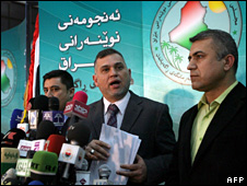 Members of the Iraqi parliamentary law committee speak after the law is passed (23 November 2009)