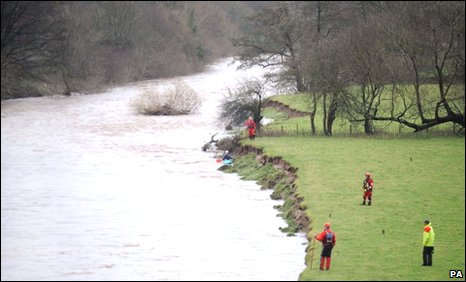 A search and rescue team on the banks of the Usk in Brecon on Sunday