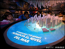 Children look at a model of projected sea level rise (Getty Images)