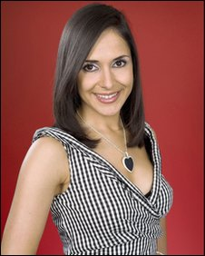 upper-body shot of Nazaneen Ghaffar wearing a black-and-white spotted dress and standing against a dark-red background.