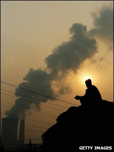 Man sitting on a pile of coal (Getty Images)