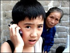 Chinese boy on a mobile phone