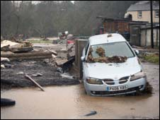 Car partially submerged in flood water in Cockermouth, Cumbria (pic: George Carrick Photography)