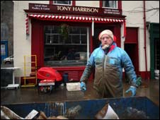 Butcher Tony Harrison clearing out ruined stock from his shop in Cockermouth, Cumbria (pic: George Carrick Photography)