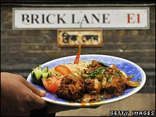Curry under street sign for Brick Lane