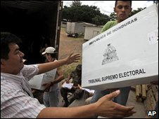 Workers distribute ballot boxes for the disputed elections in Honduras