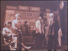 Mr Jones' grandfather (second right) outside his shop