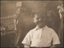 Mr Jones as a young boy outside his grandfather's shop