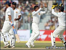 Rangana Herath celebrates the wicket of India captain Mahendra Singh Dhoni